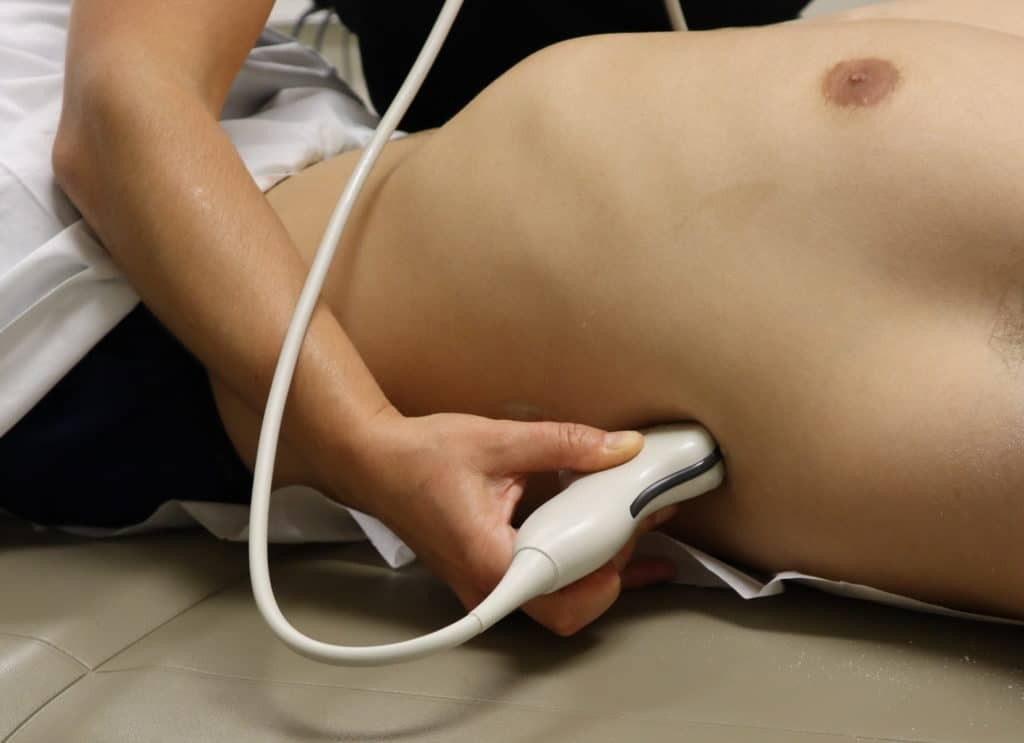 Spleen Probe and Hand Position Abdominal ultrasound